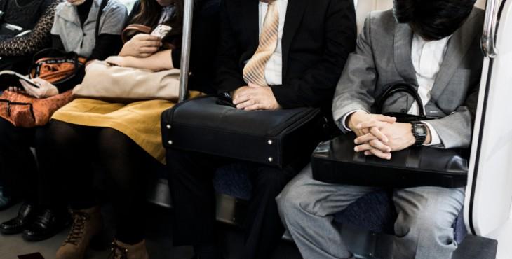 Sleeping passengers in Tokyo Japan