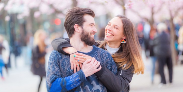 Happy hipster couple in Stockholm with cherry blossoms
