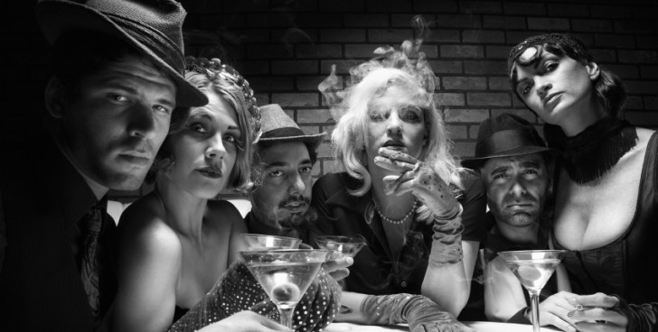 Retro group sitting in bar.