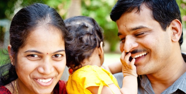 Happy Indian Family of three Cheerful Young Couple