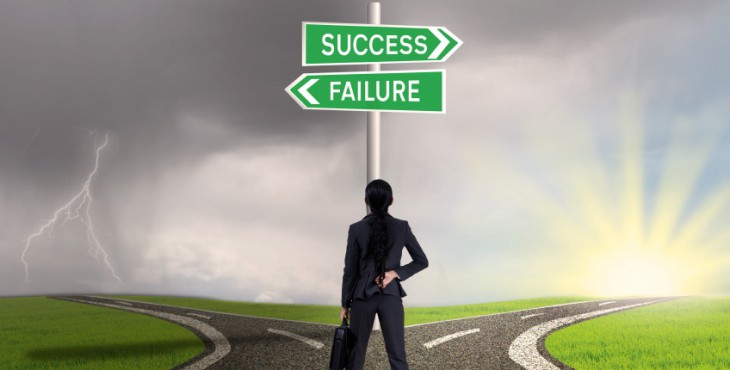 Businesswoman looking at sign of success or failure