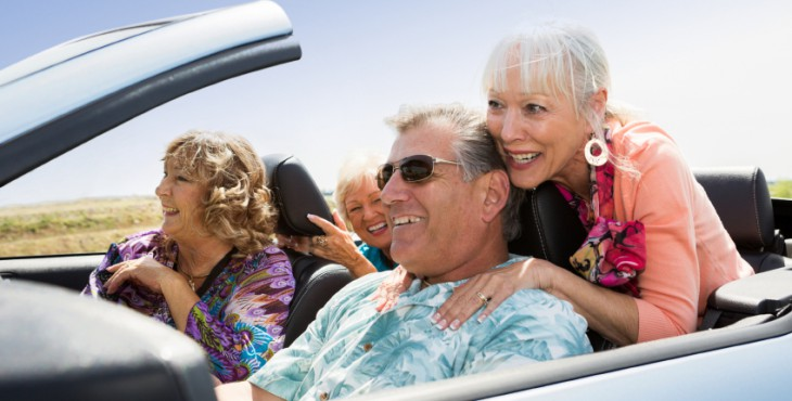 A group of seniors traveling in a converable.