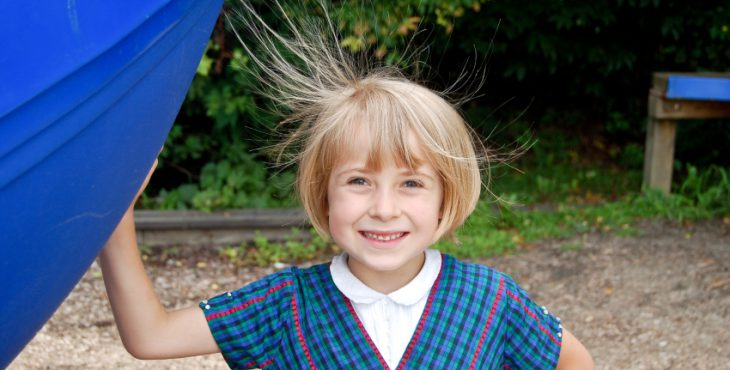 Smiling girl with static hair