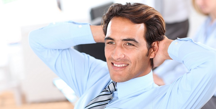 Smiling relaxed businessman in office