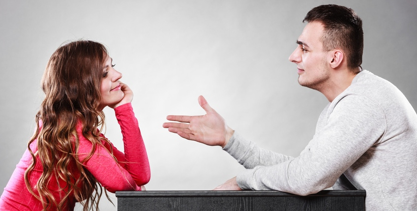 Man trying to reconcile with woman after quarrel.